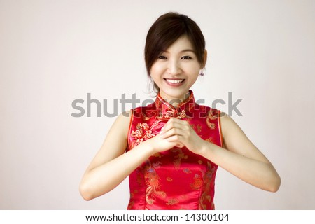Oriental girl wishing you a happy chinese new year - stock photo