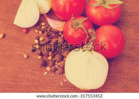 Oriental herbs and spices on a wooden background - stock photo