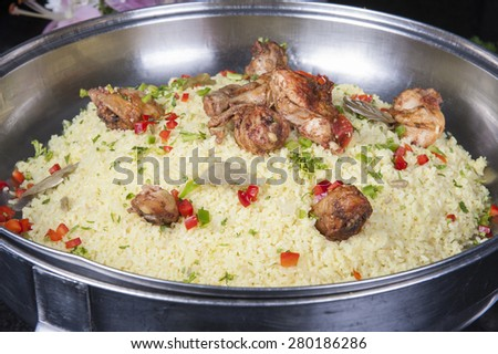 Oriental kabsa rice dish with chicken on display at a hotel restaurant buffet - stock photo
