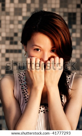 Oriental mystery of beautiful young woman face. - stock photo