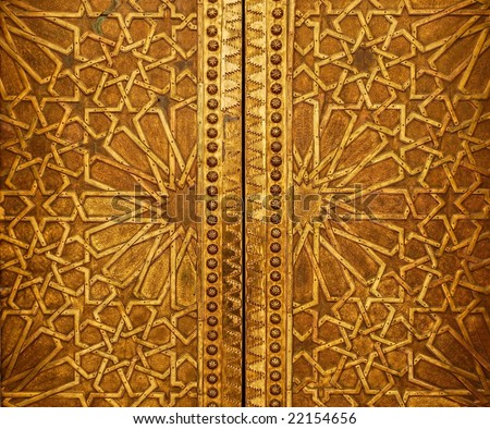 Oriental ornamented door in Marrakesh - stock photo
