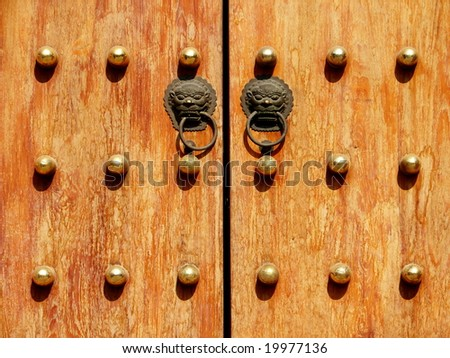 Oriental Palace's door with Lion knockers - stock photo