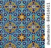 oriental pattern on wall of the mosque, lined with tiles - stock photo