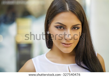 Oriental style. Sensual arabic woman model. Beautiful clean skin, saturated makeup. Bright eye make-up and dark eyeliner - stock photo