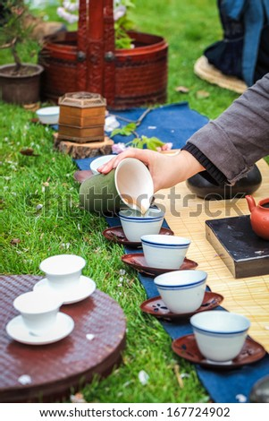 oriental traditional tea ceremony on the grass - stock photo