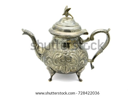 orientalic teapot with eagle on top on white background