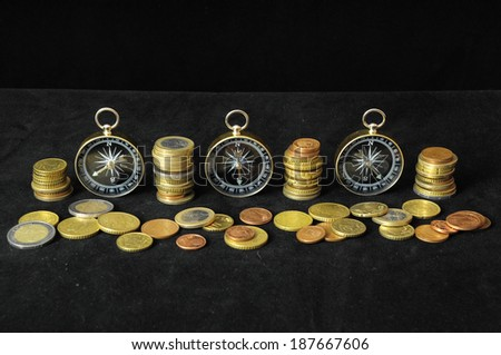 Orientation in Business Compass and Money on a Black Background - stock photo