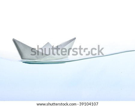 Origami boat on water. Isolated on white background - stock photo