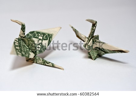 origami crane from a money note - stock photo