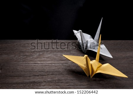 origami crane on wooden table - stock photo