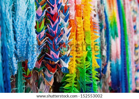 Origami cranes at Fushimi Inari Shrine in Kyoto, Japan - stock photo
