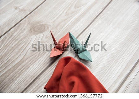 Origami cranes with red cloth - stock photo