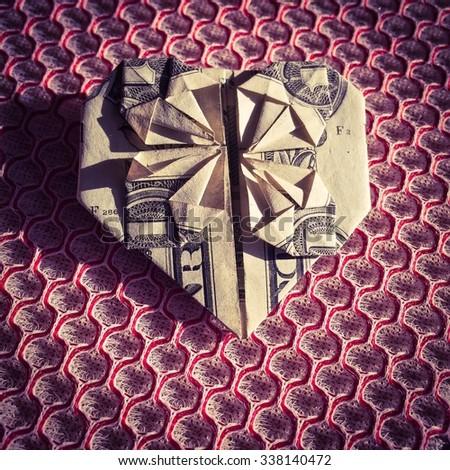 Origami Dollar Heart - stock photo