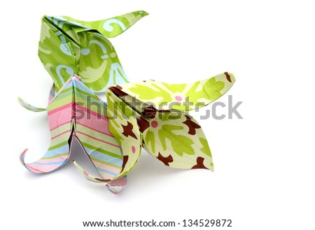 Origami flowers isolated on white background