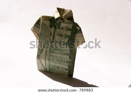 Origami folded money in the shape of a shirt - stock photo