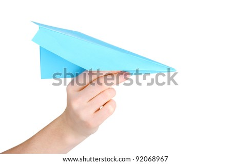 Origami paper airplane in hand isolated on white - stock photo