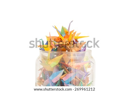 origami paper birds getting out of glass jar - stock photo
