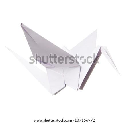 Origami paper crane isolated on white - stock photo
