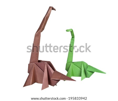 Origami. Paper figures of dinosaurs. Traditional Japanese art folding of figures from paper - stock photo