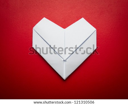 Origami  paper  heart shape symbol for Valentines day  with copy space for text or design - stock photo