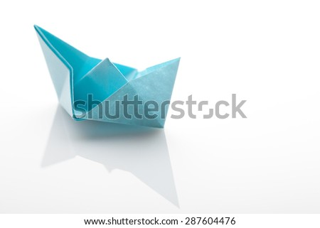 Origami paper ship on white background - stock photo