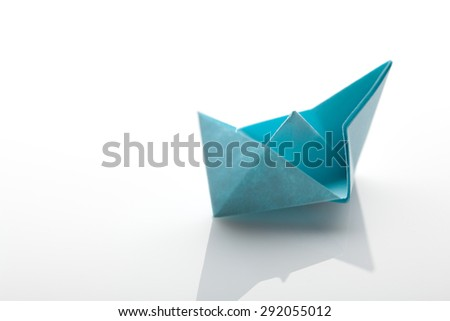 Origami paper ship on white background with Clipping Path - stock photo