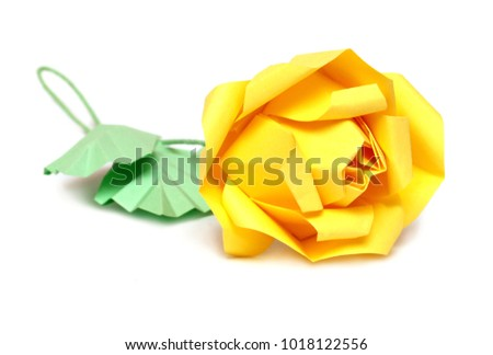 Origami rose yellow flower isolated on white background