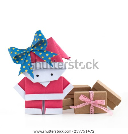 Origami Santa Claus girl paper craft with gift boxes isolated on white background - stock photo
