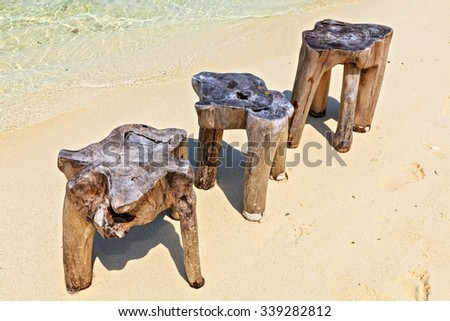Original  beach tables are made from trunk of tree, Maldives, The Indian Ocean - stock photo