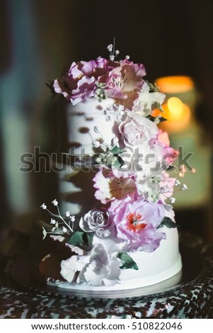 original cake with flowers prepared for a married couple
