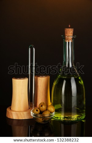 Original glass bottle with oil on dark color background