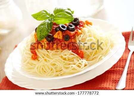 Original Italian spaghetti bolognese with basil and black olives