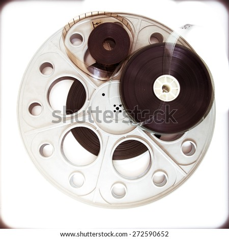 Original old big theater movie cinema 35mm loaded reel with film reels on neutral background and vintage color effect - stock photo