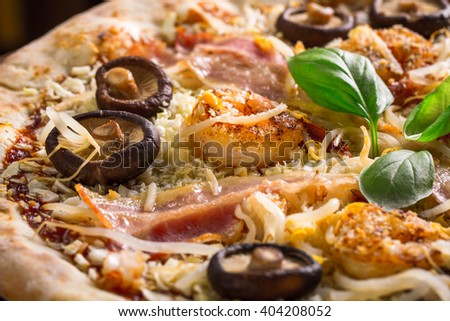 original pizza with shrimps, mushrooms and fresh basil