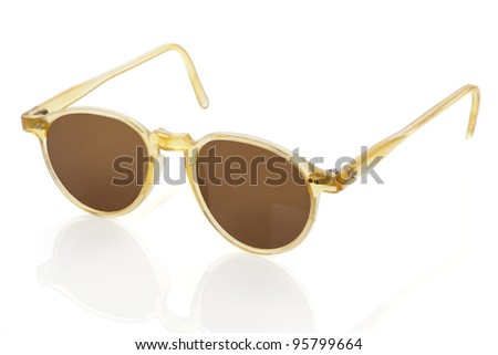 Original vintage sunglasses in brown and yellow isolated on white background. Retro collector objects.