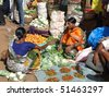 ORISSA,  INDIA - NOV 12  -	Indian villagers sell squash, cucumbers  and other vegetables at the on Nov 12, 2009 in Orissa, India - stock photo