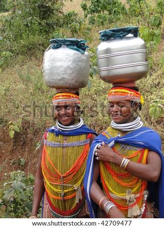 ORISSA, INDIA - NOVEMBER 12 : Bonda tribal women pose for portraits on their way to the  weekly market on November 12, 2009 in Ankadeli, Orissa, India. - stock photo