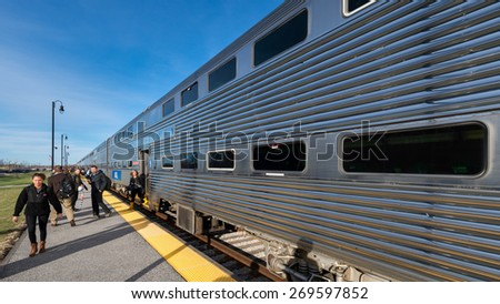 ORLAND PARK, ILLINOIS - APRIL 13: Commuters at the Orland Park Train Depot at 143rd Street & Southwest Highway on April 13, 2015 in Orland Park, Illinois - stock photo