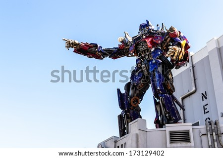 ORLANDO- DECEMBER 19 2013: The statue of Optimas Prime robot at Universal Studios  in Orlando USA. Optimus Prime is a character from the Transformers franchise. - stock photo