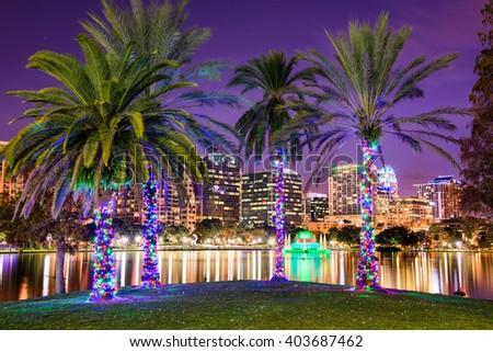 Orlando, Florida, USA downtown skyline at Eola Lake. - stock photo
