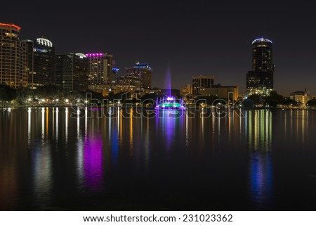 Orlando Lake Eola in the night and mirroring skyscrapers - stock photo