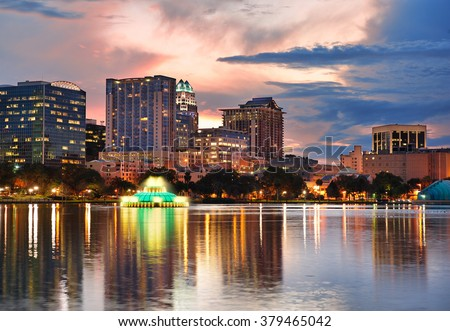 Orlando Lake Eola sunset with urban architecture skyline and colorful cloud - stock photo