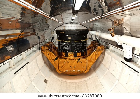 ORLANDO, USA - JULY 25: inside the space shuttle Explorer with a satellite as load in the belly  on July 25, 2010 in Orlando, USA. - stock photo