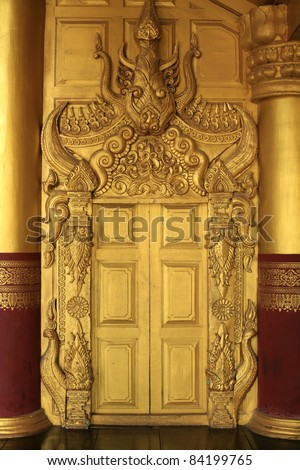 Ornament:Ancient Gold Door inside Myanmar Palace - stock photo