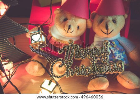 Ornament and a couple lovely bear, Christmas decorate at Merry Christmas and happy new year night light. Christmas tree and other decoration with Lovely gift and ribbon .