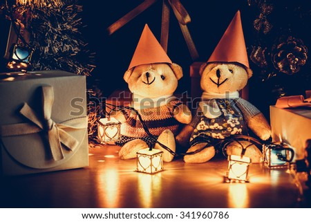 Ornament and teddy bear, Christmas decorate at Merry Christmas night light. Christmas tree and other decoration with Lovely gift and ribbon . - stock photo