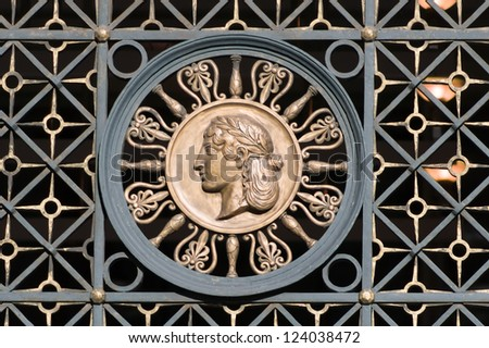 Ornament in old forged gate. A woman's head. Berlin. Charlottenstrasse 33. The building was built in 1911, architect Heinrich Schweitzer.