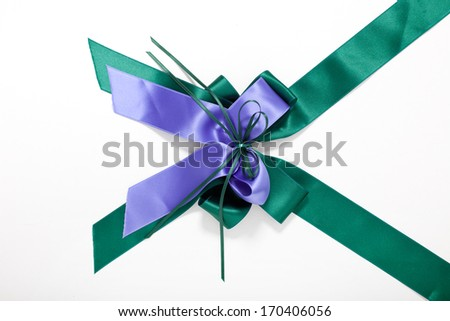 Ornamental blue and green bow for decorating that gift for someone special isolated on white - stock photo