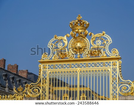 Ornamental golden front gate of Versailles Palace, France