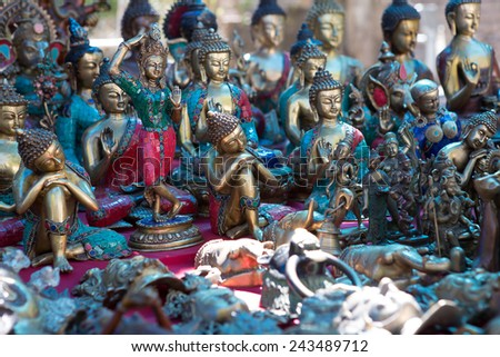 Ornamental Hindu Gods at market in Delhi, India - stock photo